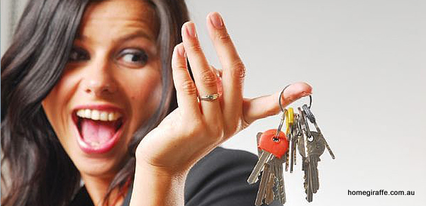 girl smiling holding a set of keys