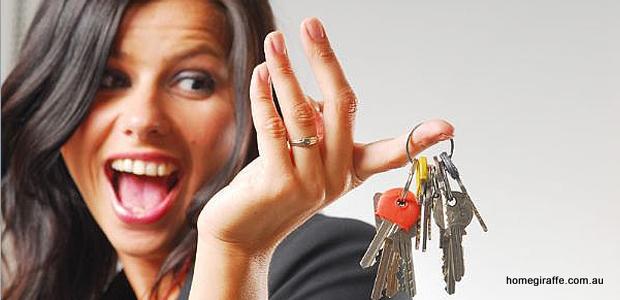 girl smiling holding a set of keys