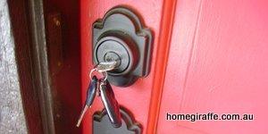 key in lock on red door
