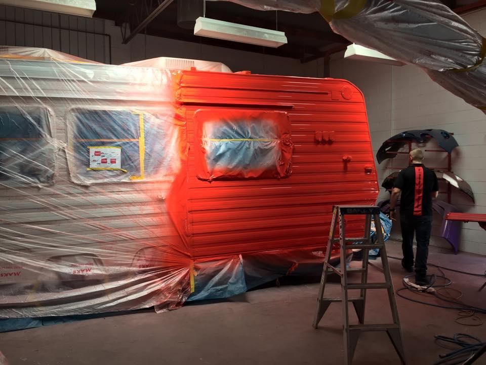 caravan spray painting red