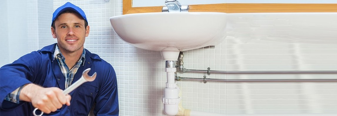 plumber fixing a sink
