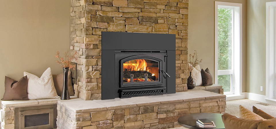 black wood heater in wall