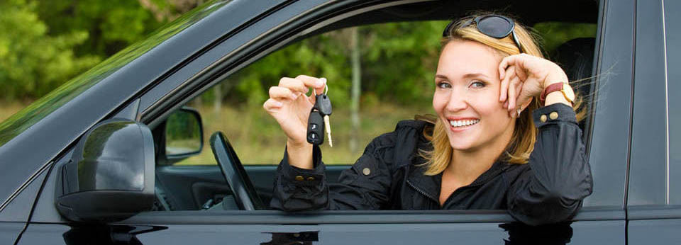 girl holding keys in a car